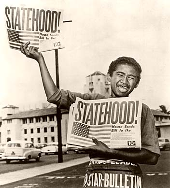 A newsboy happily hawks the Honolulu Star-Bulletin with the headline showing the state had achieved statehood, August 21, 1959. Star-Bulletin photo